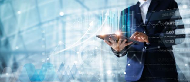 businessman-using-tablet-analyzing-data